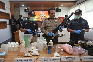 Recently seized items on display at the Jakarta police headquarters include weapons and bomb-making materials that the authorities believe were to be used to attack government buildings and the Myanmar Embassy.