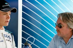 Nico Rosberg (left) talking to his father, former Formula One World Champion Keke Rosberg, before the Canadian Formula One Grand Prix on June 24, 2006.