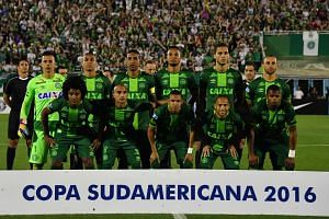 Brazil's Chapecoense players posing for pictures during their 2016 Copa Sudamericana semifinal second leg football match against Argentina's San Lorenzo on Nov 24, 2016.