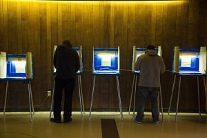 Voters cast their ballot in the national election at Cannon Pavilion on Nov 8, 2016 in Milwaukee, Wisconsin.