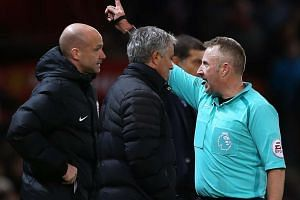 Manchester United's manager Jose Mourinho (centre) is sent off by referee Jonathan Moss (right) during match against West Ham United on Nov 27, 2016.