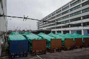 Armoured vehicles belonging to the Singapore military are seen covered with tarpaulin at a customs and excise facility in Hong Kong on Nov 25, 2016.