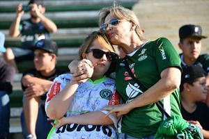 People pay tribute to the players of Brazilian team Chapecoense Real who were killed in a plane accident in the Colombian mountains, at the club's Arena Conda stadium in Chapeco, in the southern Brazilian state of Santa Catarina, on Nov 29, 2016.