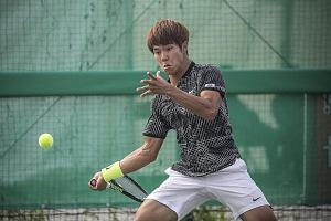 Lee Duck Hee, a professional tennis player who is deaf, playing a match in the National Sports Festival in Asan, South Korea. The 18-year-old ranks 143rd in the world in a sport in which hearing the ball is considered crucial.