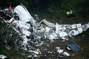 The wreckage of the Lamia plane that carried the Chapecoense Real football team in the mountains of Colombia yesterday. Brazil's President Michel Temer has declared three days of mourning for the victims. A survivor, Brazilian journalist Rafael Henze