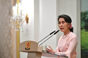 Myanmar State Counsellor Aung San Suu Kyi speaking at an official dinner hosted by PM Lee Hsien Loong at the Istana, on Nov 30, 2016.