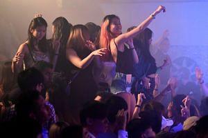 Partygoers dancing in Zouk's main room in the morning of Dec 4, 2016.