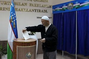 A man casting his ballot during the presidential election in Tashkent, Uzbekistan, on Dec 4, 2016.