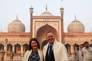 New Zealand's Prime Minister John Key and his wife Bronagh pose for a photograph during their visit to the Jama Masjid (Grand Mosque) in the old quarters of Delhi, India on Oct 27, 2016.