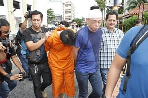 The 37-year-old bodyguard (in orange), who shot dead a Datuk businessman and two others at the Tun Dr Lim Chong Eu Expressway last week, had apparently been upset by his boss' questioning over his firearm.