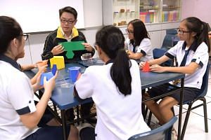 Hougang Secondary's HOD of Mathematics Edwin Cheong teaching students maths with geometric shapes.