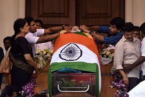 Indian supporters and ministers gather alongside the coffin of Tamil Nadu Chief Minister Jayalalithaa Jayaram in Chennai, India, on Dec 6, 2016.