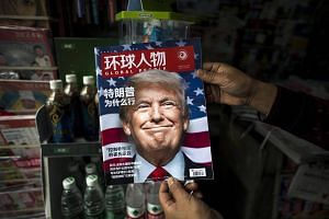 "A copy of the local Chinese magazine Global People with a cover story that translates to ""Why did Trump win"" at a news stand in Shanghai, on Nov 14, 2016."