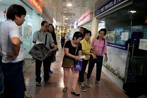 Madam Teo (in yellow shirt) and her friend had paid for their tour and got their itineraries. But hours before the flight, she allegedly received a text message saying the agency had closed.