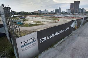 Signage for 1Malaysia Development Berhad (1MDB) is displayed at the site of the Tun Razak Exchange project in Kuala Lumpur.