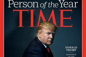 US President-elect Donald Trump poses for photographer Nadav Kander for the cover of Time Magazine after being named its person of the year.