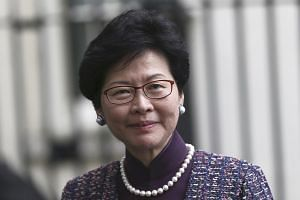 Hong Kong's Chief Secretary Carrie Lam has signalled that she may join the race for the Chief Executive post, a reversal of her previous statements.