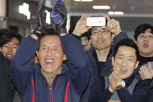 South Koreans reacting to a live broadcast of a parliamentary vote on a motion to impeach scandal-ridden President Park Geun Hye on Dec 9, 2016.