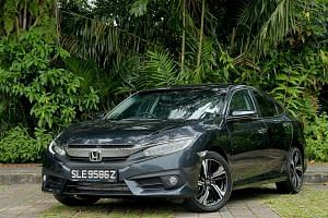 The Honda Civic has LED headlamps and tail lamps, 17-inch wheels and a rear spoiler.
