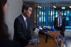 Hong Kong Chief Executive Leung Chun Ying announcing his decision not to seek a second term at a news conference in Hong Kong yesterday. Mr Leung, who took office in 2012, said his decision was not due to a lack of recognition from Beijing.