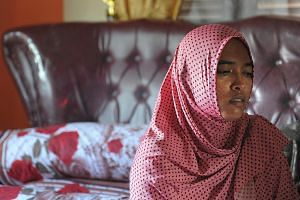 Ms Yusra Fitriani grieving in what was to be her bridal bedroom. Her fiance and seven members of his family, who had travelled to the province to attend the wedding, were killed in Wednesday's quake.