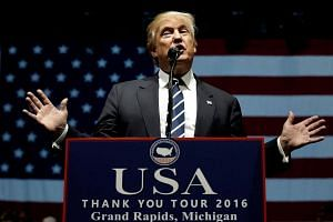 US President-elect Donald Trump speaks at a 'Thank You USA' tour rally in Grand Rapids, Michigan on Dec 9, 2016.