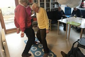 This rehabilitative game makes use of interactive tiles to help seniors (from left) Hans Joergen and Bendt Fogh improve their balance and reflexes while having a fun workout at the Vennerslund Day Centre.