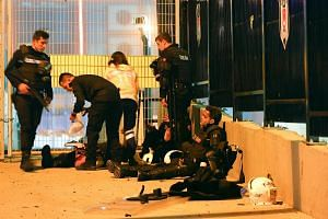 Turkish policemen at the site of the attack receiving treatment last Saturday night. Thirty-eight people were killed in two explosions outside the Vodafone Arena stadium in what appeared to be a coordinated attack on police after a match between two