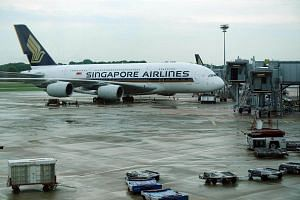 A Singapore Airlines (SIA) plane parked on the tarmac at Changi Airport Terminal 3.