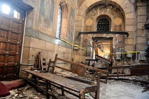 A general view shows the damage inside St. Peter and St. Paul Coptic Orthodox Church following a bombing in Cairo, Egypt, on Dec 11, 2016.