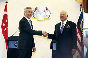 Prime Minister Lee Hsien Loong and his Malaysian counterpart Najib Razak witnessed the signing of a historic bilateral agreement to build a high-speed rail line between the two countries on Dec 13, 2016.