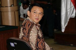 The security at the Jakarta court was tight as Governor Basuki (above) took the stand yesterday and said he had no intention of insulting Islam.