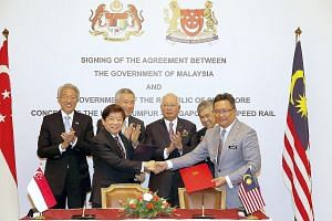 PM Lee and Mr Najib, flanked by their deputy prime ministers Teo Chee Hean (left) and Ahmad Zahid Hamidi, witnessed the signing of the HSR pact yesterday by Singapore's Coordinating Minister for Infrastructure and Minister for Transport Khaw Boon Wan