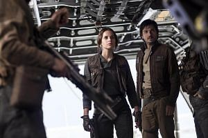 Jyn Erso (Felicity Jones) and Cassian Andor (Diego Luna) in Rogue One: A Star Wars Story.