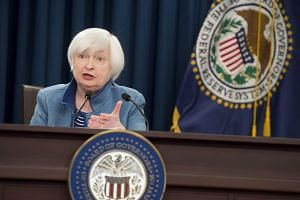 Federal Reserve Chair Janet Yellen speaks during a press conference following the announcement that the Fed will raise interest rates.