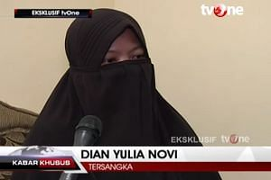 "Screen grab from a TVOne interview with Dian Yuli Novi, one of two women held over a suicide-bomb plot to strike the Jakarta presidential palace with a high-grade bomb. The woman said she had worked in Singapore for 11/2 years and was ""active"" on Fac"