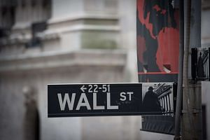 Wall Street stocks opened higher Thursday (Dec 15) as the market weighed the downside of a strengthening US dollar following the Federal Reserve's decision to hike interest rates.