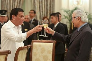 President Tan and President Duterte toasting last night at a banquet in honour of the visiting Philippine leader. Dr Tan said Singapore companies are keen to invest in the Philippines.