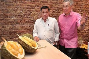 """PM Lee with Mr Duterte at lunch yesterday. Noting it was the second time this week he was having durians, Mr Lee said: """"International diplomacy is indeed dangerous for waistlines!"""""""