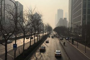 The smog situation in Beijing at East 3rd Ring road on Saturday (Dec 17) at 11.30am.