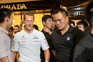 Michael Schumacher (second from left) visiting Paragon in Singapore in 2011.