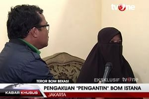 Dian Yulia Novi (in a TV interview, above) says she is self-radicalised but observers say her husband influenced her to be a suicide bomber.