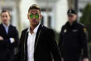 Barcelona's Brazilian forward Neymar leaves Spain's national court in Madrid on Feb 2, 2016.