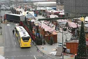 The attack at the Christmas market at Breitscheidplatz in Berlin left a trail of destruction. The city's police chief has said that they may have arrested the wrong man, and the suspect could be armed and still at large.