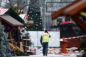 A policeman at the Christmas market near the Kaiser-Wilhelm-Gedaechtniskirche the day after the truck attack in central Berlin, Germany, on Dec 20, 2016.
