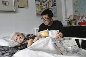 Mr Goh, 58, with his mother, Madam Seet, 84, who had a severe case of pressure ulcer on her spine and required an operation to remove the rotting flesh.