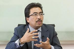 "Datuk Johari has downplayed tensions with Abu Dhabi over $9.4 billion in debt obligations, saying the two sides are ""not in arbitration""."