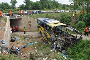 The destroyed bus lying near the underpass in Kampung Jayor after it veered off KM137 of the north-south expressway before Pagoh, Johor on Dec 24, 2016.