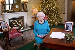 Britain's Queen Elizabeth II sits at a desk in the Regency Room in Buckingham Palace in London, after recording her Christmas Day broadcast to the Commonwealth, on Dec 25, 2016.