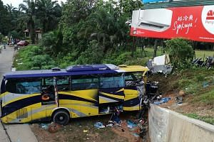 A handout photo from the Malaysia Fire and Rescue Department taken on Dec 24, 2016, shows the wreckage of a bus after it crashed in Muar, outside Kuala Lumpur.